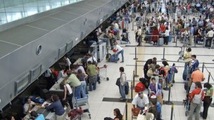File photo of passengers checking in at Buenos Aires airport
