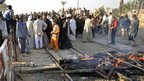 Site of crash between a bus and a train in southern Egypt, 17 November 2012