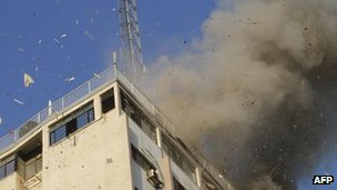 Smoke from Israeli air strike on building housing Hamas TV and other media organisations (18 Nov)