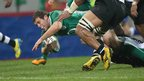 Ulster centre Darren Cave surges forward to register a try as Ireland take control against Fiji