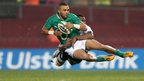 Ireland full-back Simon Zebo takes to the air after a strong tackle from Saula Radidi
