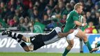 Fiji's Nemani Nagusa gets a firm grip on Ireland centre Luke Marshall