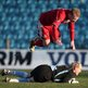 Cliftonville striker Liam Boyce leaps over Ballymena United goalkeeper Dwayne Nelson at the Showgrounds