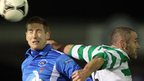 Ballinamallard's Conor O'Grady and Conor Downey of Donegal Celtic go up for the ball