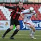 Crusaders striker Jordan Owens competes against Portadown defender Brian Gartland at Seaview