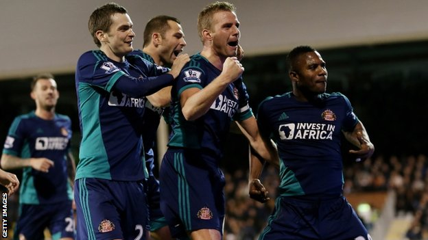 Sunderland players celebrate their third goal