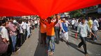 Shiv Sena members with party flag at Bal Thackeray's funeral, Mumbai (18 Nov)