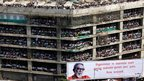 People in unfinished building watch Bal Thackeray's funeral procession (18 Nov)
