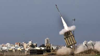 An Israeli missile is launched from the Iron Dome defence missile system in the southern Israeli city of Ashdod, 18 Nov