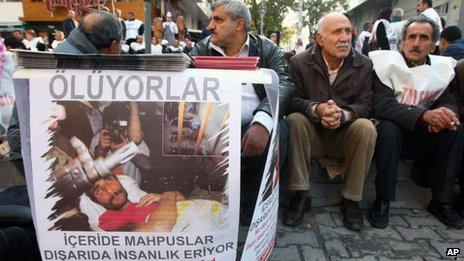Members of a pro-Kurdish party sit as they start a two-day hunger strike to support several hundreds Kurdish inmates who are on a hunger strike in jails for 67 days, in Ankara