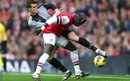 Tottenham's Gareth Bale tangles with Arsenal's Bacary Sagna during the North London derby at the Emirates Stadium.