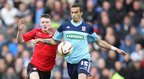 Cardiff's Joe Mason and Boro's Seb Hines battle for the ball