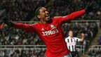Jonathan de Guzman celebrates after scoring Swansea's second goal in their 2-1 win at Newcastle.