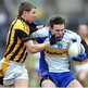 Martin Aherne of Crossmaglen challenges Errigal Ciaran opponent Ciaran McGinley during the semi-final at Clones
