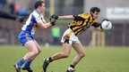 Aidan McCrory of Errigal Ciaran attempts to halt the progress of Crossmaglen Rangers forward Jamie Clarke