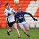 Kilcoo's Daryl Branagan gets the ball away as Karl Stewart closes in
