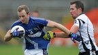 Michael Pollock of St Gall's in action against Kilcoo's Sean O'Hanlon - Kilcoo won 1-9 to 0-10 to go through to the final where they will meet All-Ireland champions Crossmaglen Rangers