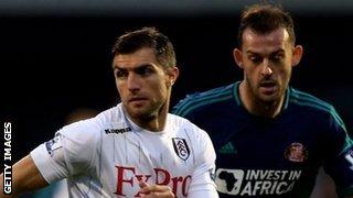 Steven Fletcher (r) challenges Fulham's Aaron Hughes