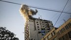 Smoke billows from media building in Gaza City following an Israeli air strike 18/11/2012