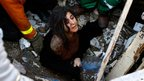 A young woman is rescued from the rubble of a house destroyed by an Israeli strike in Gaza City 18/11/2012