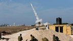 Israeli soldiers watch as an Iron Dome launcher fires an interceptor rocket near the southern city of Ashdod 18/11/2012