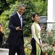 US President Barack Obama and Burmese opposition leader Aung San Suu Kyi walk together during their meeting at her home in Rangoon