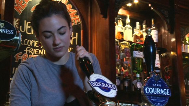 A pint being poured in a London pub