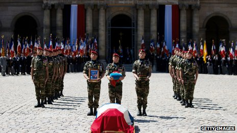 French soldiers honour the coffin of General Bigeard at a ceremony at Les Invalides in Paris