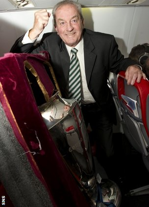 Lisbon Lion Stevie Chalmers on board Celtic's flight to Portugal with the 1967 European Cup