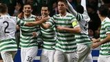 Celtic players celebrate goal against Barcelona