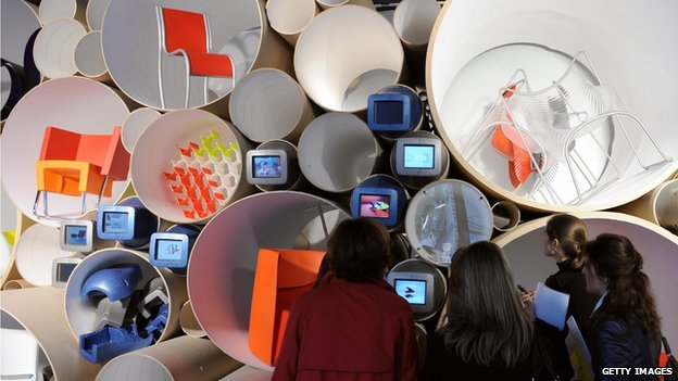 Visitors to the Centre Pompidou, in Paris, look at work by industrial designer Ron Arad