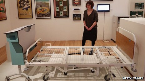 A woman views Kenneth Agnew's Prototype Kings' Fund Bed at the Royal College of Art