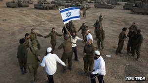 Israeli soldiers dance with Hasidic Jews near the Gaza border. Photo: 19 November 2012