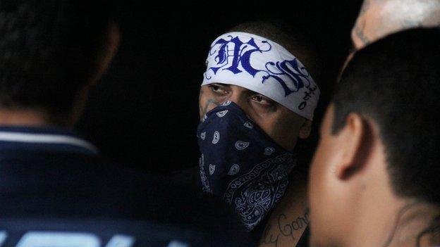 A Mara Salvatrucha leader with a bandana covering his face