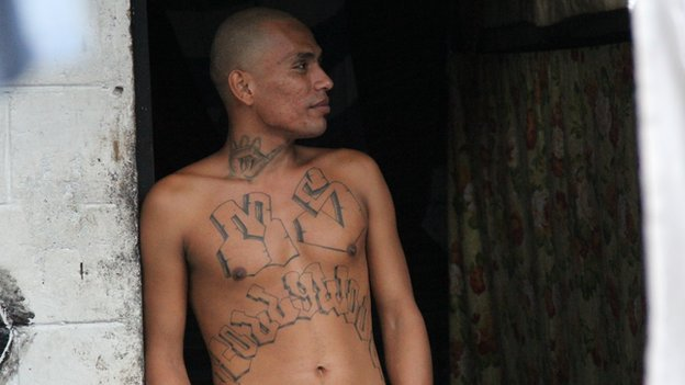A Mara Salvatrucha gang member with chest tattoos