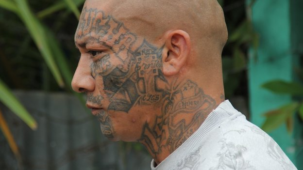 A Mara Salvatrucha gang member with a tattooed face