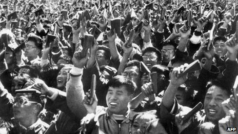 "Chinese youths waving copies of Chairman Mao Zedong's ""Little Red Book"" as the celebrates China's National Day in Beijing, October 1967"