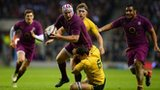 Thomas Waldrom of England is tackled by Dave Dennis of Australia during the game at Twickenham on 17 November