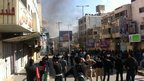 Trouble breaks out during the funeral of Hamdi Mohammed Jawad al-Fallah in the West Bank city of Hebron