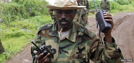 A rebel uses a walkie-talkie in Goma in the eastern Democratic Republic of Congo on 20 November 2012