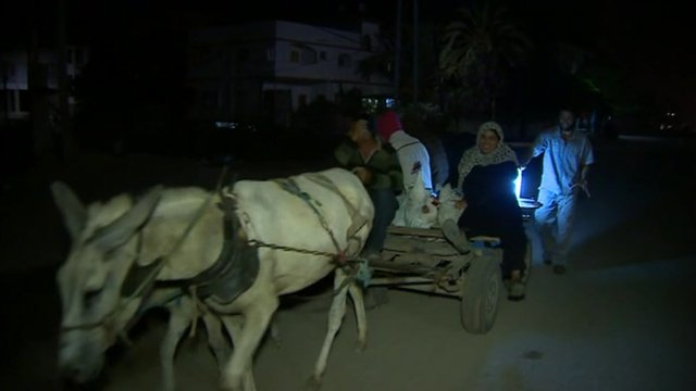 Donkeys and carts take people from their homes