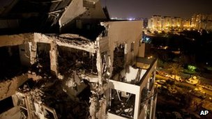 A damaged residential building by a rocket fired from the Gaza Strip, in the Israeli central city of Rishon Lezion, near Tel Aviv, 20 November 2012.