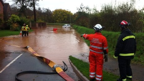 Flooding in Budlake Road, Marsh Barton, Exeter