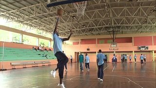 Youths playing basketball