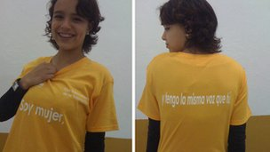 """A student at Colegio Newland in Mexico models a t-shirt. The slogan reads: """"I'm a woman, and I have the same voice as you."""""""