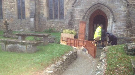 Floodwater being diverted away from a church in Leonard Stanley