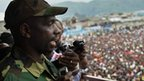 M23 rebels spokesperson Lt Col Vianney Kazarama speaks to a crowd who have gathered at a stadium in Goma