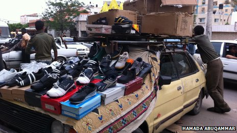 Shoe shop on the back of a van