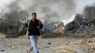A Palestinian man reacts after an Israeli air strike near smuggling tunnels between the southern Gaza Strip and Egypt, on November 21, 2012 in Rafah.