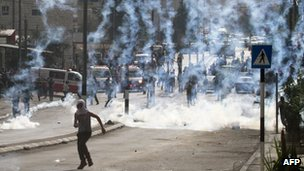 Youth runs away from tear gas fired in Bethlehem clashes